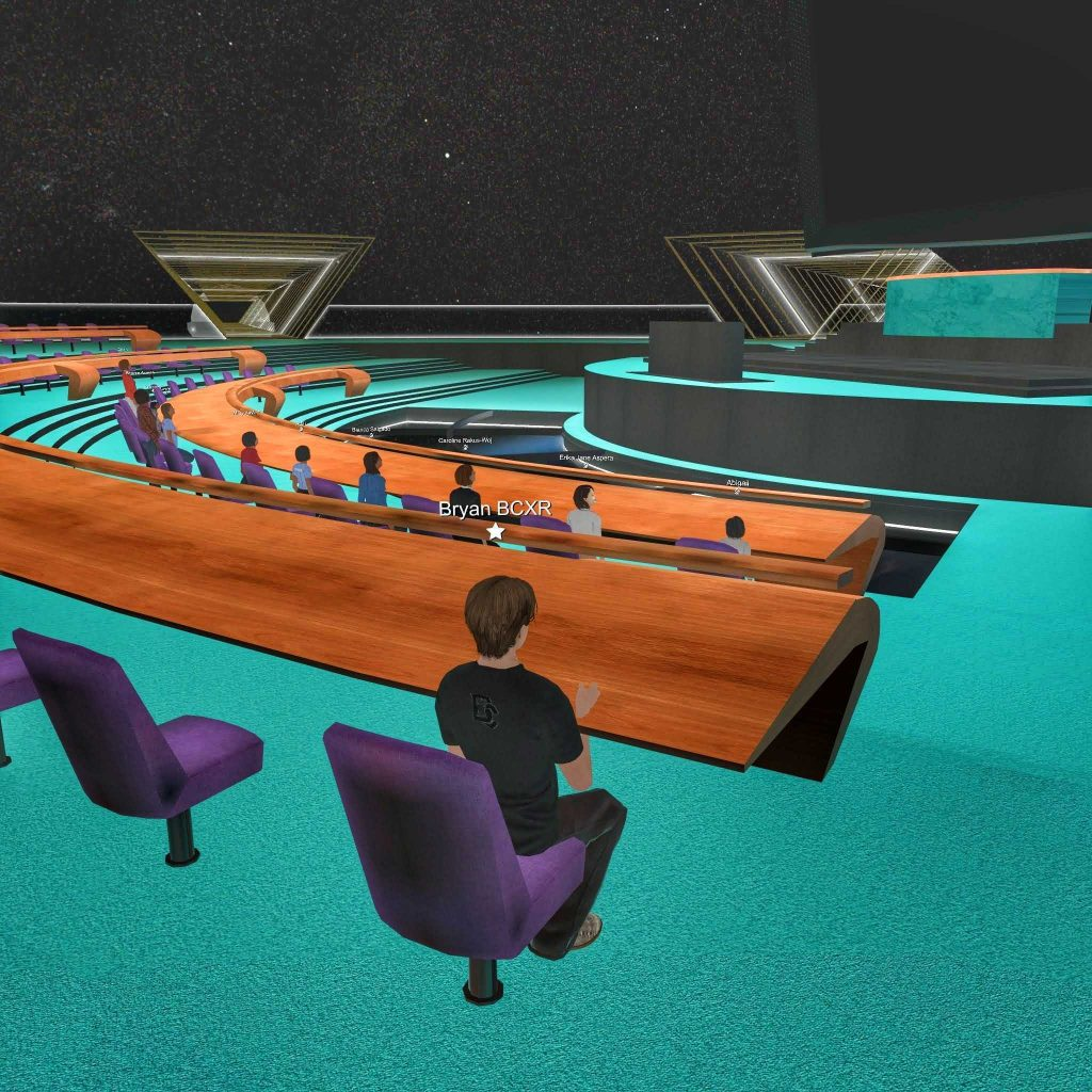 VR world showing avatars seated at a UN inspired general assembly hall