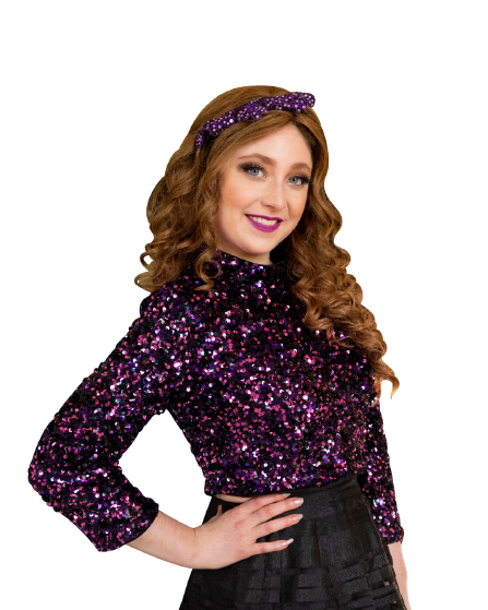 Kelly Lovell with long curly hair, a sequin headband and purple sequin top